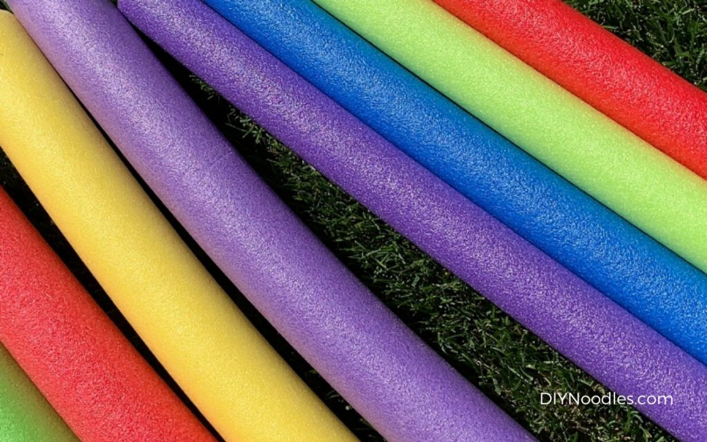 Pool noodles in the grass